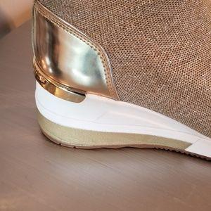 07a2cc58aa96 Michael Kors Shoes - Skyler Metallic Knit High-Top Trainer